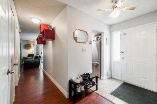 "Photo 4: 101 13316 71B Avenue in Surrey: West Newton Townhouse for sale in ""Sun Creek"" : MLS®# R2611543"