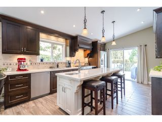 "Photo 10: 4544 205 Street in Langley: Langley City House for sale in ""MOSSEY ESTATES"" : MLS®# R2427406"