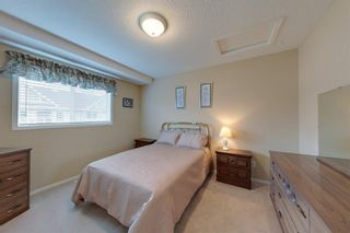 Photo 21: 38 1008 Woodside Way NW: Airdrie Row/Townhouse for sale : MLS®# A1123458