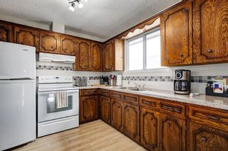 Photo 8: 8347 CENTRE Street NW in Calgary: Beddington Heights House for sale