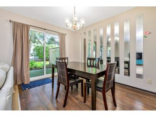 """Photo 5: 103 7349 140 Street in Surrey: East Newton Townhouse for sale in """"Newton Park"""" : MLS®# R2464654"""