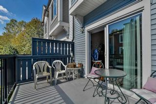 """Photo 13: 105 3010 RIVERBEND Drive in Coquitlam: Coquitlam East Townhouse for sale in """"WESTWOOD"""" : MLS®# R2109754"""