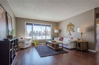Photo 3: 75 SUMMERWOOD Road SE: Airdrie House for sale : MLS®# C4174518