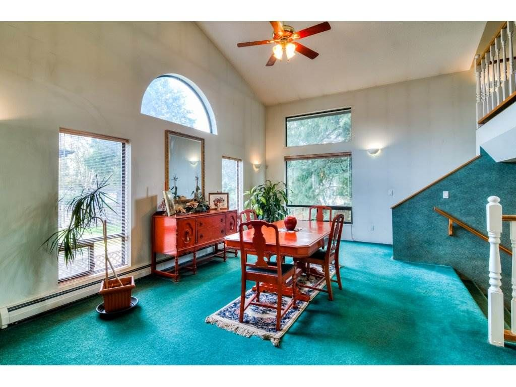 HAVE YOUR LARGE FAMILY GATHERINGS IN THE OVERSIZED DINING ROOM WITH HIGH VAULTED CEILINGS AND LARGE PICTURE WINDOWS.