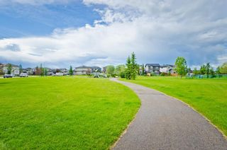 Photo 32: 205 2006 LUXSTONE Boulevard SW: Airdrie Row/Townhouse for sale : MLS®# A1010440
