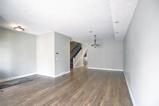 Photo 5: 1715 College Lane SW in Calgary: Lower Mount Royal Row/Townhouse for sale : MLS®# A1134459