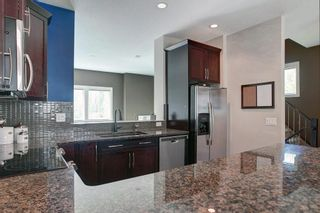 Photo 18: 1707 WENTWORTH Villa SW in Calgary: West Springs Row/Townhouse for sale : MLS®# C4253593