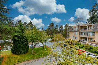 """Photo 1: 201 1740 SOUTHMERE Crescent in Surrey: Sunnyside Park Surrey Condo for sale in """"Capstan Way: Spinnaker II"""" (South Surrey White Rock)  : MLS®# R2526550"""