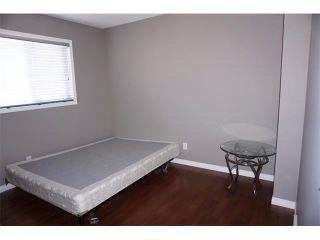 Photo 19: 25 MARTIN CROSSING Green NE in Calgary: Martindale House for sale : MLS®# C4017520
