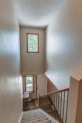 Photo 28: 17 Eversyde Court SW in Calgary: Evergreen Row/Townhouse for sale : MLS®# A1120200