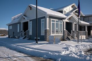 Photo 1: 108 Creekside Drive SW in Calgary: C-168 Semi Detached for sale : MLS®# A1062823