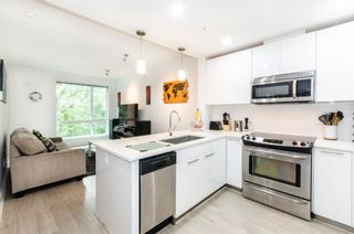"""Photo 1: 404 733 W 3RD Street in North Vancouver: Harbourside Condo for sale in """"The Shore"""" : MLS®# R2603581"""