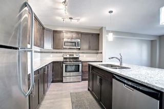 Photo 4: 555 Redstone View NE in Calgary: Redstone Row/Townhouse for sale : MLS®# A1149779