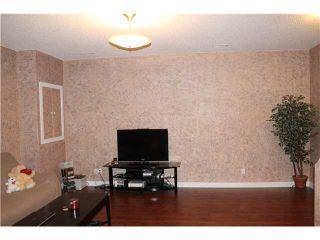 Photo 17: 102 AUBURN CREST Way SE in Calgary: Auburn Bay Residential Detached Single Family for sale : MLS®# C3643783