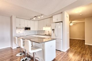 Photo 8: 509 55 ARBOUR GROVE Close NW in Calgary: Arbour Lake Apartment for sale : MLS®# A1096357
