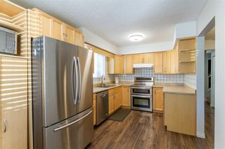 Photo 6: 19881 53 Avenue in Langley: Langley City 1/2 Duplex for sale : MLS®# R2607336
