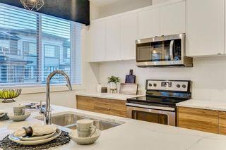 Photo 7: 4369 Seton Drive SE in Calgary: Seton Row/Townhouse for sale : MLS®# A1129782