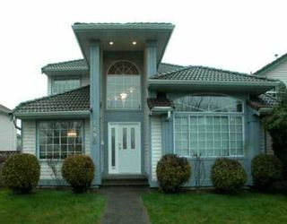"""Photo 1: 2496 COAST MERIDIAN Road in Port Coquitlam: Riverwood House for sale in """"BIRCHLAND MANOR"""" : MLS®# V635754"""