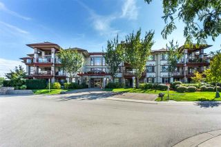 """Photo 1: 107 16447 64 Avenue in Surrey: Cloverdale BC Condo for sale in """"St. Andrews"""" (Cloverdale)  : MLS®# R2302117"""