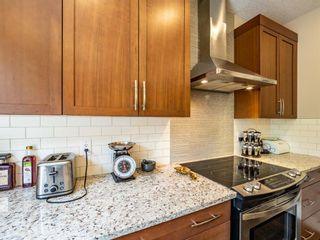 Photo 12: 159 ST MORITZ Drive SW in Calgary: Springbank Hill Detached for sale : MLS®# A1116300