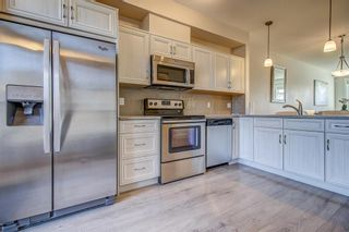 Photo 3: 100 Legacy Main Street SE in Calgary: Legacy Row/Townhouse for sale : MLS®# A1095155