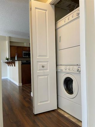 Photo 7: 108 48 Panatella Road NW in Calgary: Panorama Hills Apartment for sale : MLS®# A1063178