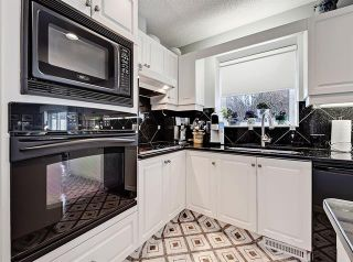 Photo 14: 127 COACHWOOD CR SW in Calgary: Coach Hill House for sale ()  : MLS®# C4229317