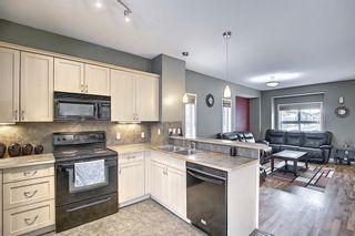 Photo 3: 5107 111 Tarawood Lane NE in Calgary: Taradale Row/Townhouse for sale : MLS®# A1071290