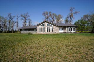 Photo 1: 32149 Road 68 N in Portage la Prairie RM: House for sale : MLS®# 202112201