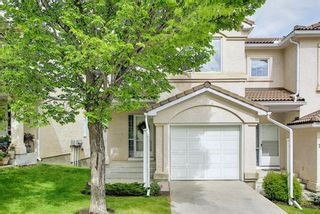 Photo 1: 106 Hamptons Link NW in Calgary: Hamptons Row/Townhouse for sale : MLS®# A1117431