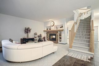 Photo 7: 163 Springbluff Heights SW in Calgary: Springbank Hill Detached for sale : MLS®# A1153228