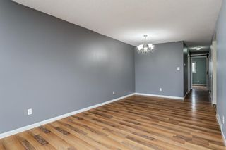 Photo 4: 5607 4 Street SW in Calgary: Windsor Park Semi Detached for sale : MLS®# A1106549