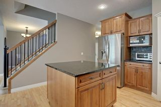 Photo 12: 145 TREMBLANT Place SW in Calgary: Springbank Hill Detached for sale : MLS®# A1024099