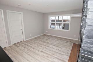 Photo 5: 2102 10 Market Boulevard SE: Airdrie Apartment for sale : MLS®# A1054506
