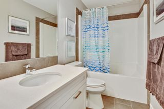 Photo 28: 207 Kinniburgh Road: Chestermere Semi Detached for sale : MLS®# A1057912
