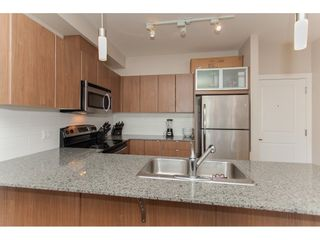 """Photo 9: 322 9655 KING GEORGE Boulevard in Surrey: Whalley Condo for sale in """"GRUV"""" (North Surrey)  : MLS®# R2134761"""