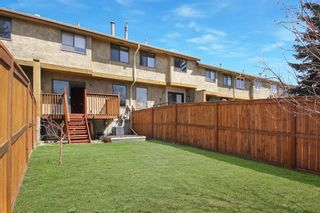 Photo 16: 1433 Ranchlands Road NW in Calgary: Ranchlands Row/Townhouse for sale : MLS®# A1128096