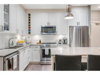 """Photo 11: 105 16380 64 Avenue in Surrey: Cloverdale BC Condo for sale in """"The Ridgse and Bose Farms"""" (Cloverdale)  : MLS®# R2556734"""