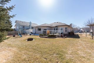 Photo 35: 144 Harrison Court: Crossfield Detached for sale : MLS®# A1086558