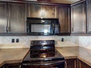 Photo 5: 23 2565 HANNA Crescent in Edmonton: Zone 14 Townhouse for sale : MLS®# E4237895