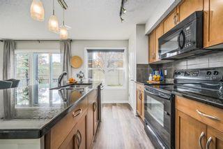 Photo 2: 120 250 New Brighton Villas SE in Calgary: New Brighton Apartment for sale : MLS®# A1140023