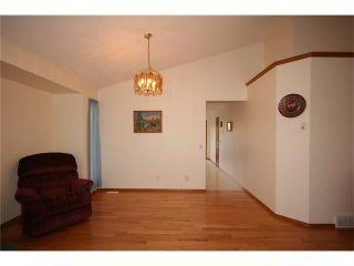 Photo 15: 31 RIVERVIEW Close: Cochrane House for sale : MLS®# C4055630
