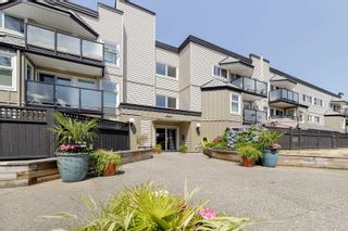 """Photo 1: 217 1850 E SOUTHMERE Crescent in Surrey: Sunnyside Park Surrey Condo for sale in """"SOUTHMERE PLACE"""" (South Surrey White Rock)  : MLS®# R2603585"""