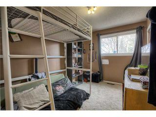Photo 12: 869 QUEENSLAND Drive SE in CALGARY: Queensland Residential Attached for sale (Calgary)  : MLS®# C3616074