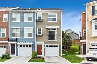 Photo 1: 17 Sherwood Row NW in Calgary: Sherwood Row/Townhouse for sale : MLS®# A1137632