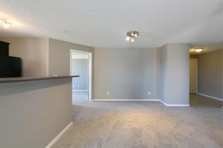 Photo 6: 8329 304 MACKENZIE Way SW: Airdrie Apartment for sale : MLS®# A1128736