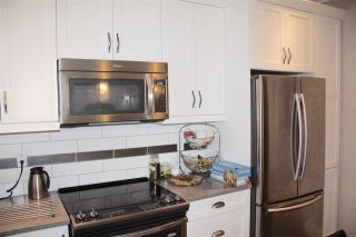 """Photo 7: 16 6929 142 Street in Surrey: East Newton Townhouse for sale in """"Redwood"""" : MLS®# R2139277"""