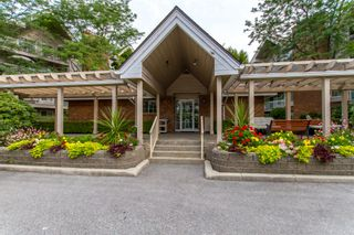"Photo 1: 405 2963 BURLINGTON Drive in Coquitlam: North Coquitlam Condo for sale in ""BURLINGTON ESTATES"" : MLS®# R2393460"