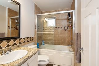 """Photo 16: 101 3333 DEWDNEY TRUNK Road in Port Moody: Port Moody Centre Townhouse for sale in """"CENTREPOINT"""" : MLS®# R2378597"""