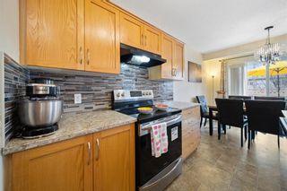 Photo 5: 146 Cranfield Crescent SE in Calgary: Cranston Detached for sale : MLS®# A1095687
